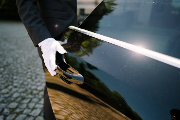photo of a driver opening the car door stock photo