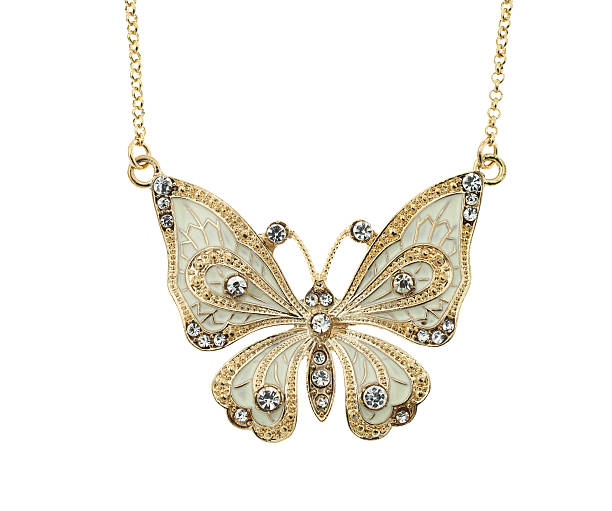 Photo of a golden butterfly necklace on a white background stock photo