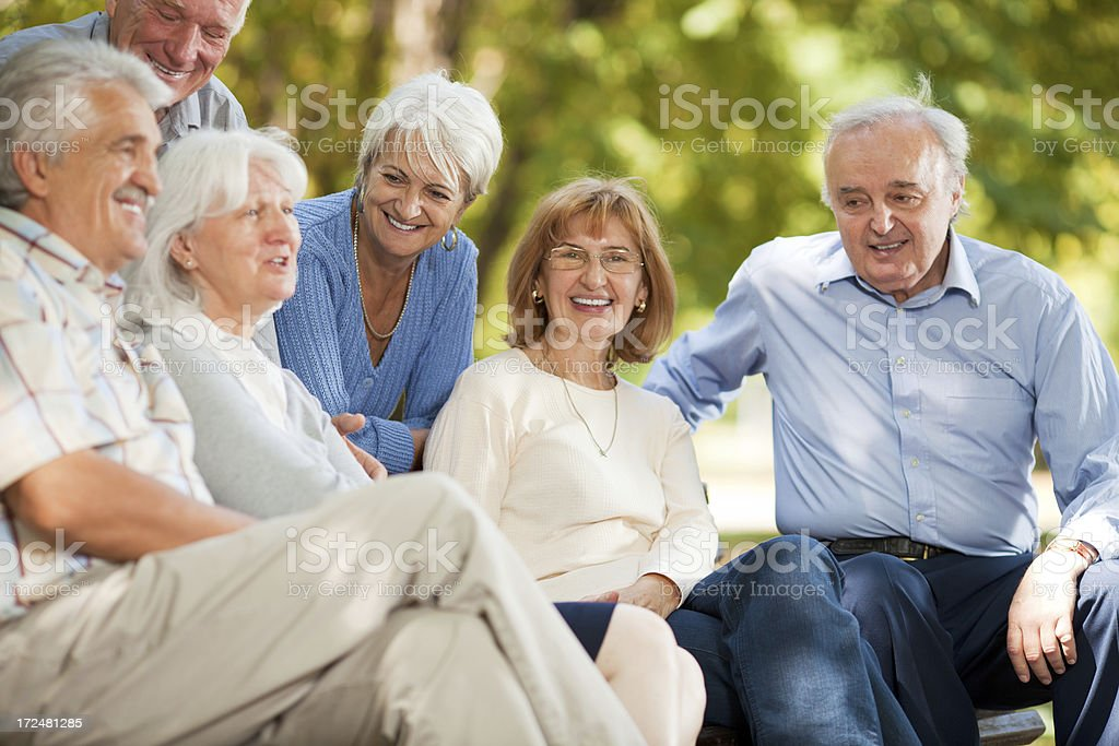 Photo of a group of smiling senior people in park royalty-free stock photo