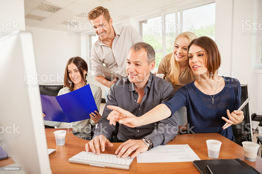 Photo of a group of studentts and mentor in office royalty-free stock photo