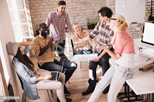 istock Photo of a group smiling designers relaxing 480586839