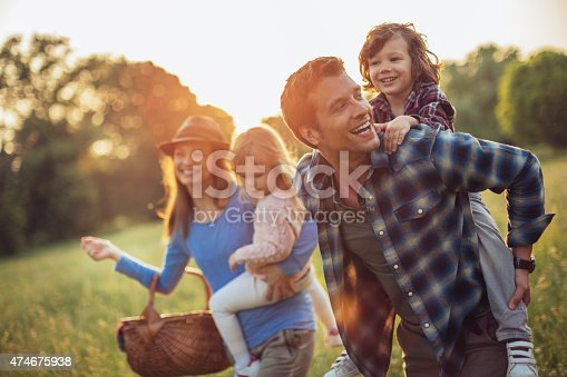istock Photo of a happy family going for picnic 474675938
