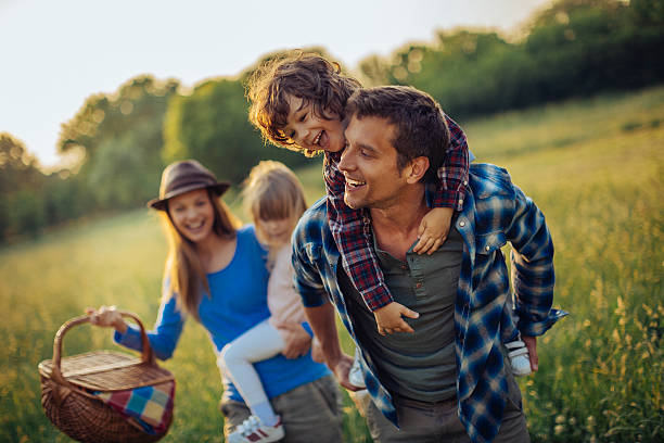 photo of a happy family going for picnic - picnic stock pictures, royalty-free photos & images