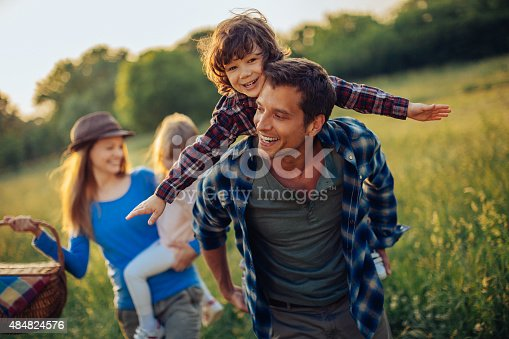 istock Photo of a happy family going for picnic 484824576