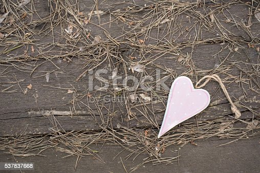 Photo of a heart shape on wooden background