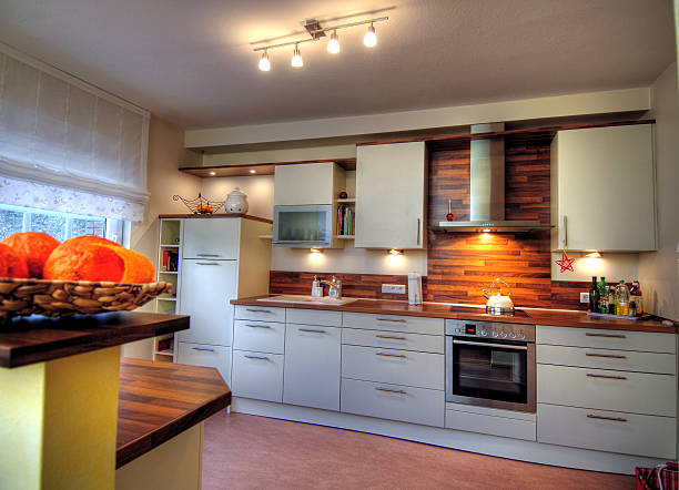 A photo of a kitchen with white cabinets stock photo