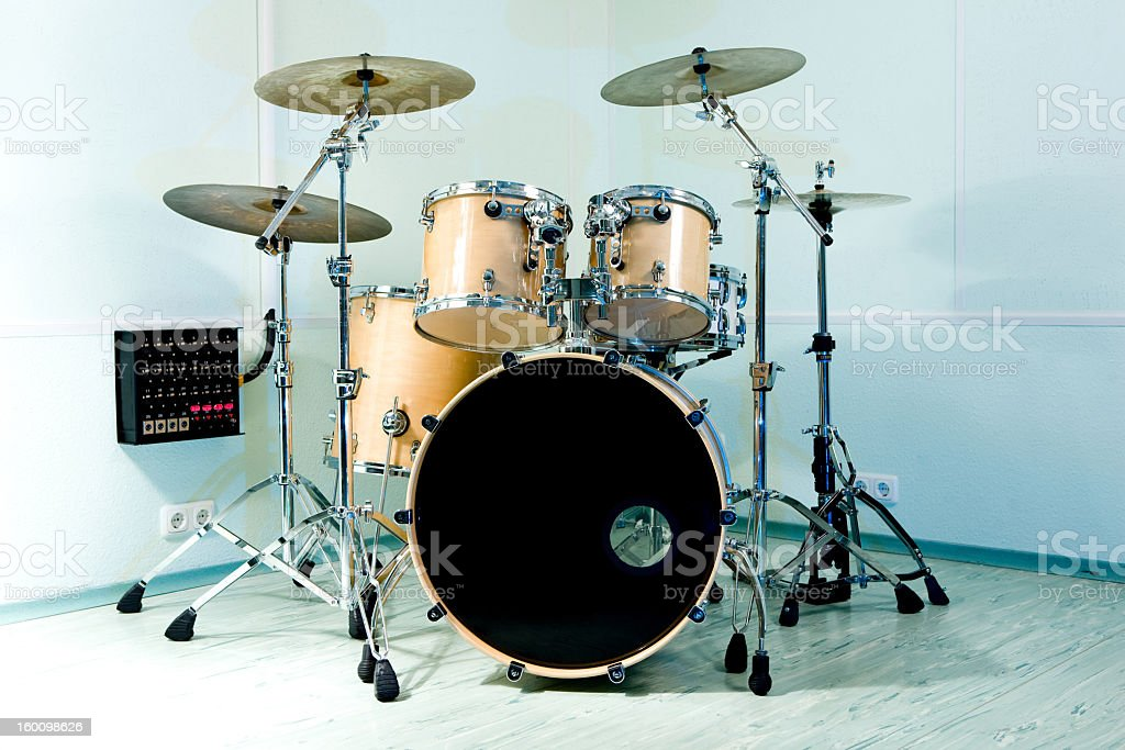 Photo of a large drum set with four cymbals on stands stock photo