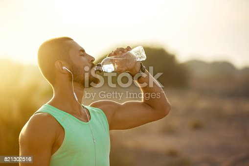 istock Photo of a man drinking water 821302516