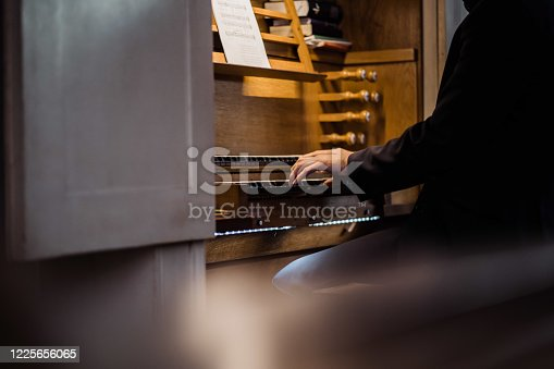 a man playing piano in a church