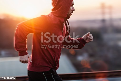 Photo Of A Man Running While Sun Is Setting Stock Photo & More Pictures of 20-29 Years