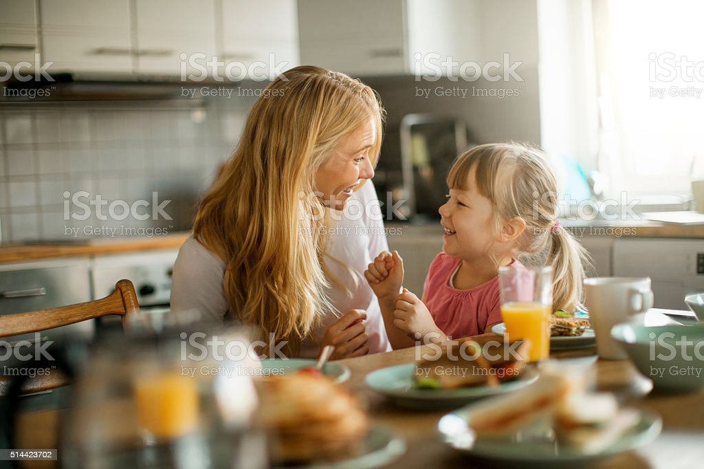 Photo of a mother and daughter having breakfast bildbanksfoto