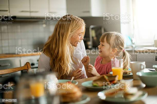 Photo Of A Mother And Daughter Having Breakfast Stock Photo - Download Image Now