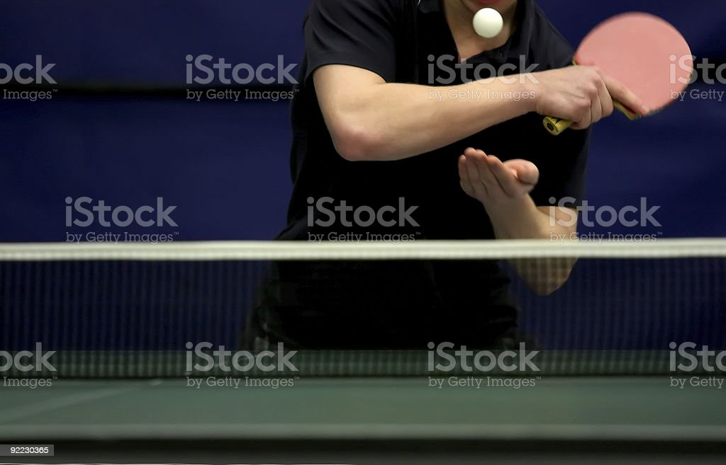 Photo of a person serving in a table tennis game  stock photo