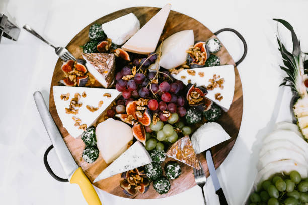 photo of a plate with different types of cheese stock photo