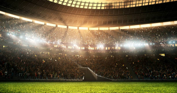 Photo of a professional soccer stadium while the sun shines stock photo