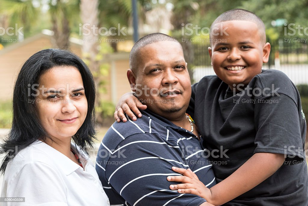 Photo of a real Hispanic family. stock photo