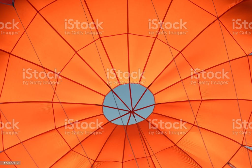 Photo of a red parachute from inside during flight stock photo