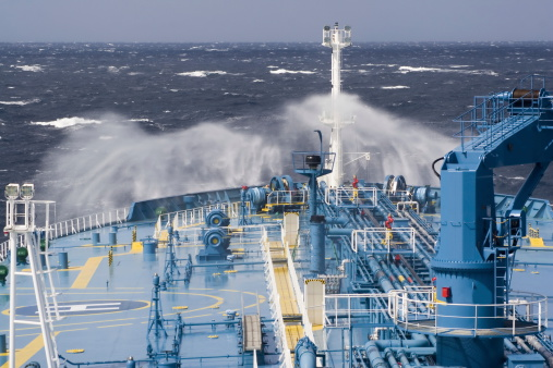 A photo of a ships bow in the ocean