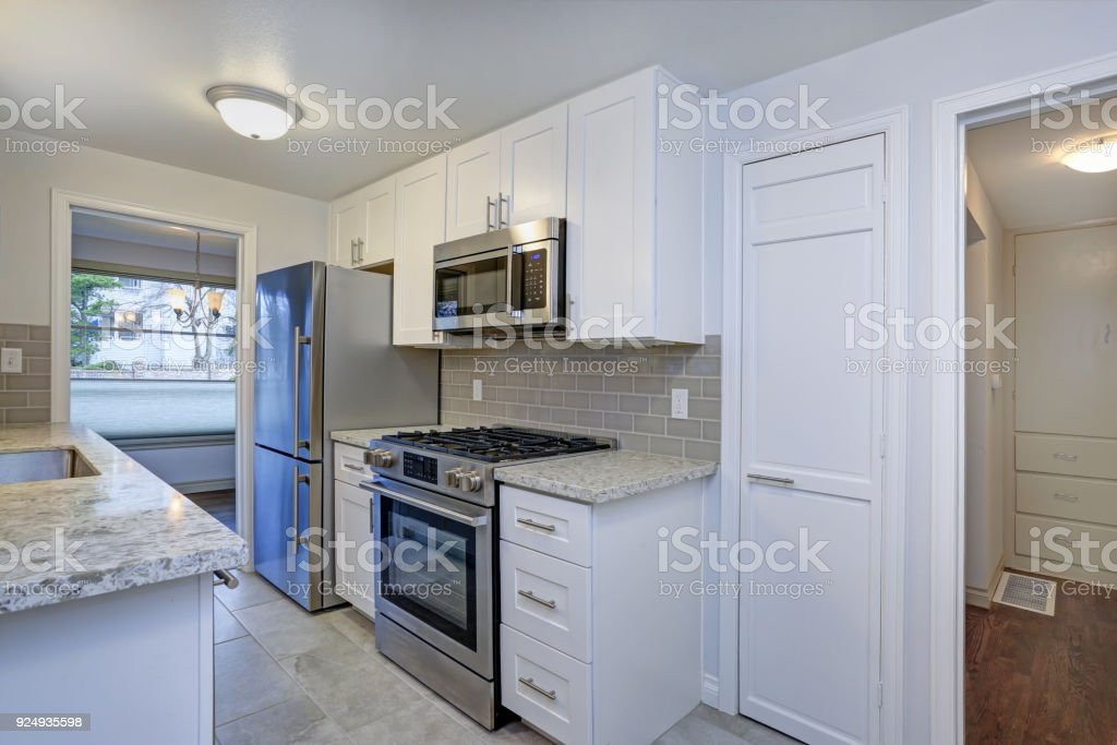 Photo Of A Small Compact Kitchen With White Shaker Cabinets Stock Photo Download Image Now Istock