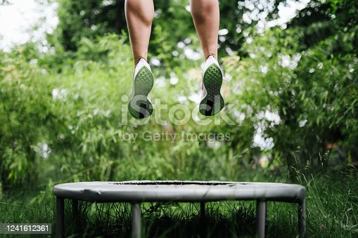 a sport woman jumping on a trampoline