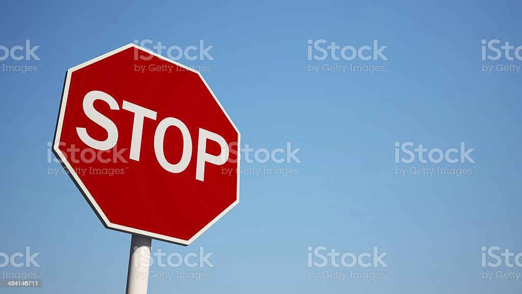 Photo of a stop sign with blue sky background stock photo
