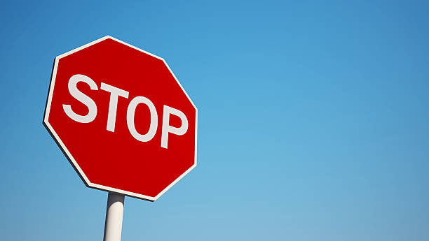 photo of a stop sign with blue sky background - stop sign stock pictures, royalty-free photos & images