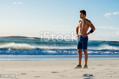 519676858istockphoto photo of a strong man taking a break from jogging 518371250