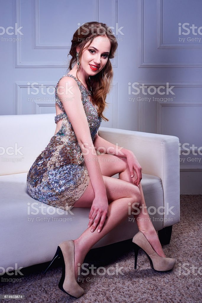 Photo of a stunning blonde woman in luxurious glitter dress. royalty-free stock photo