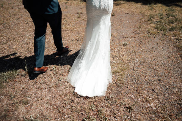 photo of a wedded couple walking in a park stock photo