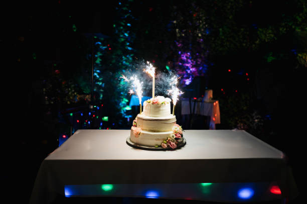 photo of a wedding cake with fireworks stock photo