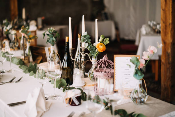photo of a wedding dinner table with candles stock photo