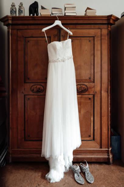 photo of a wedding dress hanged on a closet stock photo