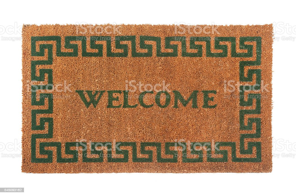 Photo of a welcome door mat isolated on a white background stock photo
