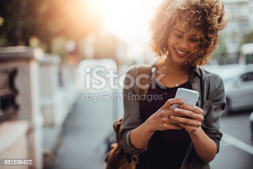 istock Photo of a woman using smart phone 531536422