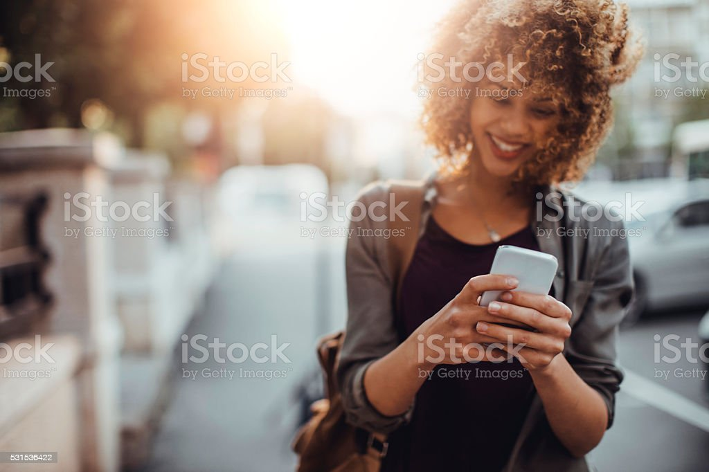Photo of a woman using smart phone stock photo