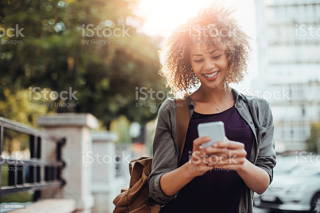 Photo of a woman using smart phone bildbanksfoto