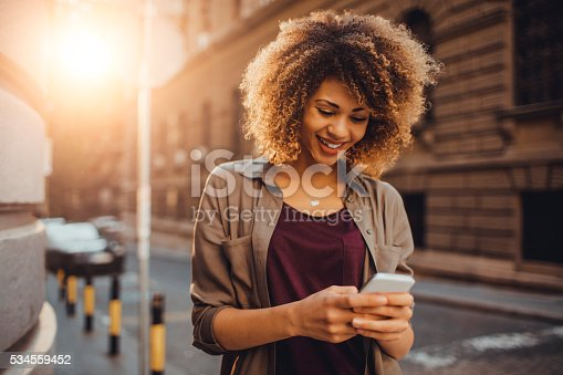 istock Photo of a woman using smart phone 534559452