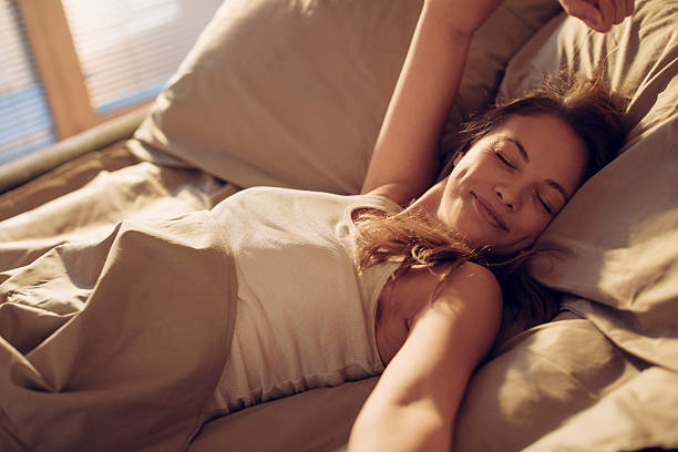 Photo of a woman waking up stock photo
