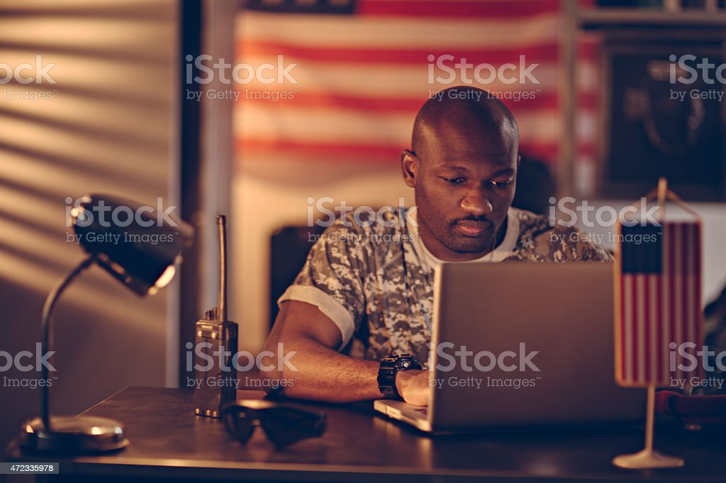 Photo of a young american soldier with laptop stock photo