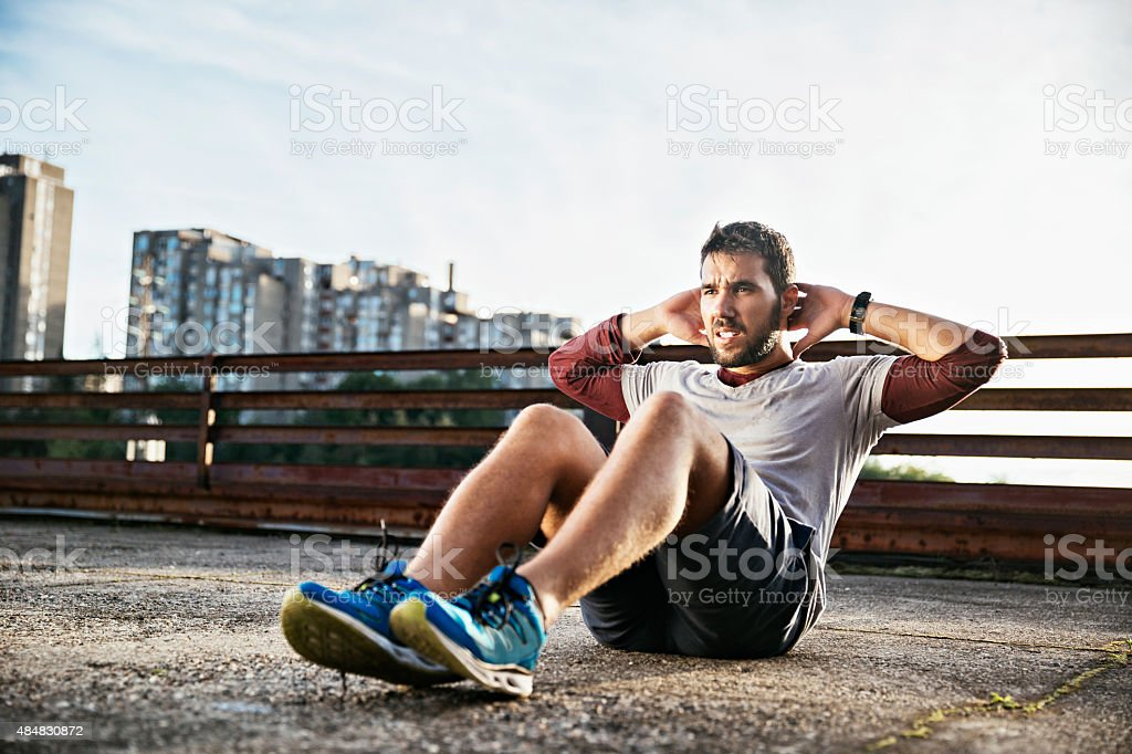 Photo of a young athletic man exercising outdoors stock photo