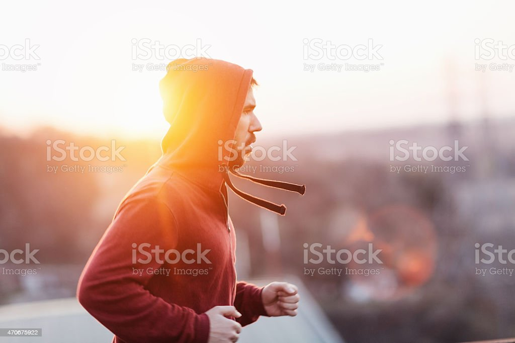 Photo of a young athletic man running outdoors stock photo