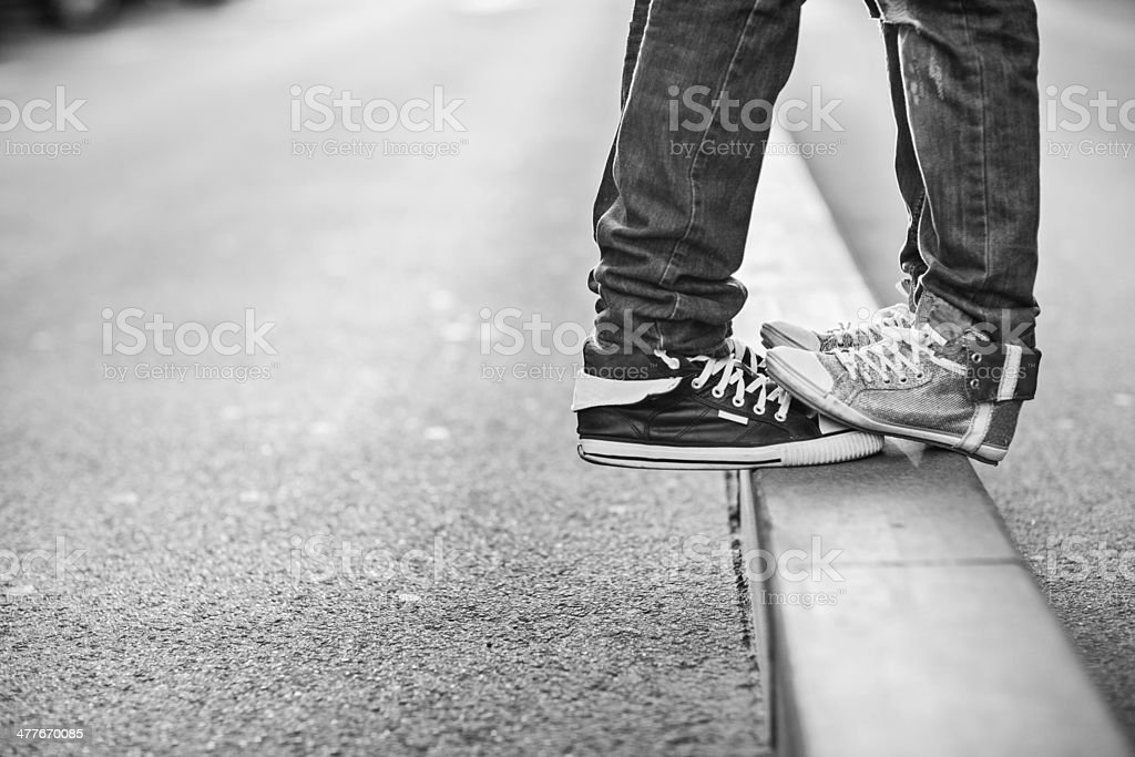 Photo of a young cuoples feet standing in the street stock photo