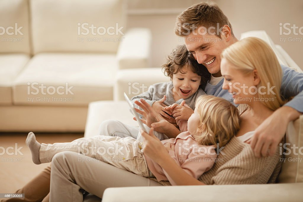 Photo of a young family looking at tablet together stock photo