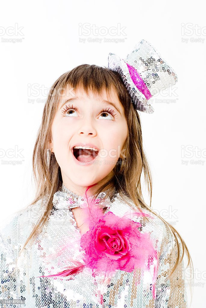Photo of a young girl dressed as a clown and looking in awe royalty-free stock photo