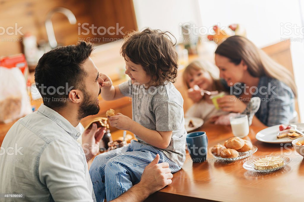 Photo of a young happy family having breakfast bildbanksfoto