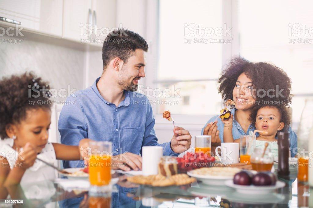 Photo of a young happy family having breakfast stock photo