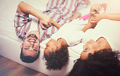 istock Photo of a young happy family playing in bed 851889256