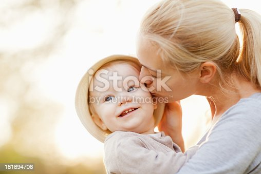 istock Photo of a young mother kissing her daughters cheek 181894706