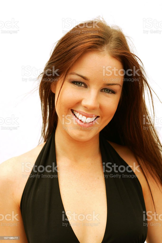 Photo of a young smiling brunette woman with a low cut shirt royalty-free stock photo