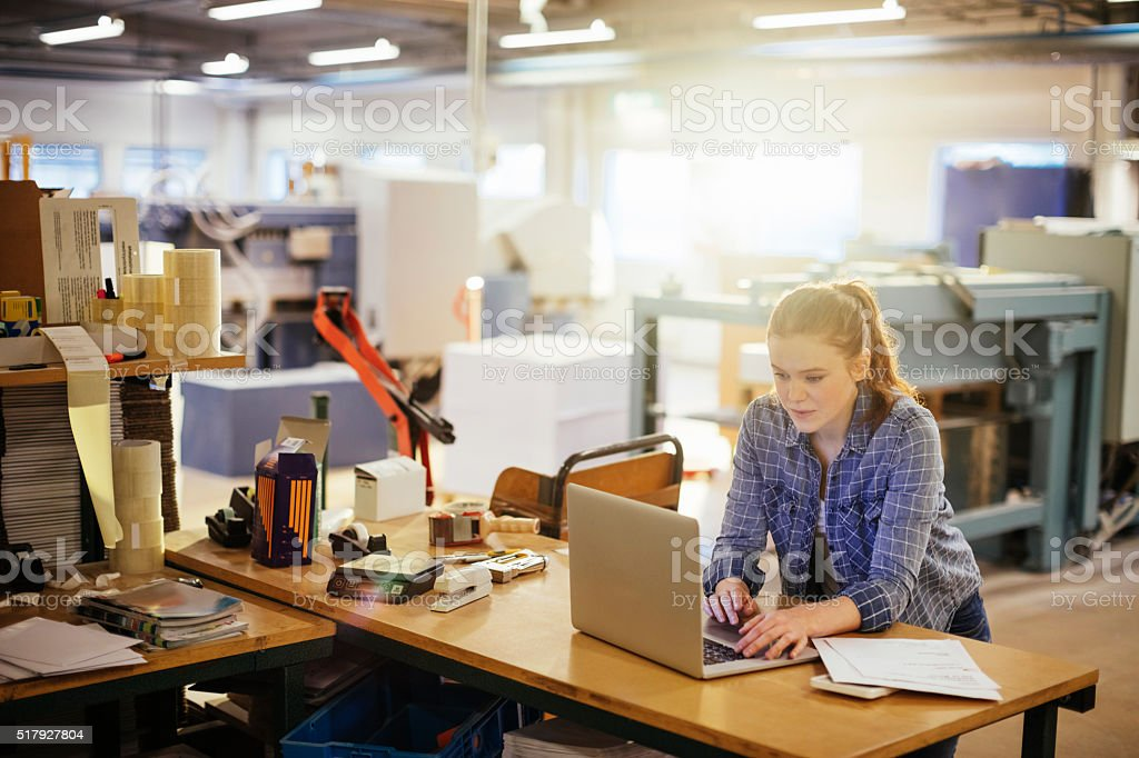 Photo of a young woman in printing factory stock photo